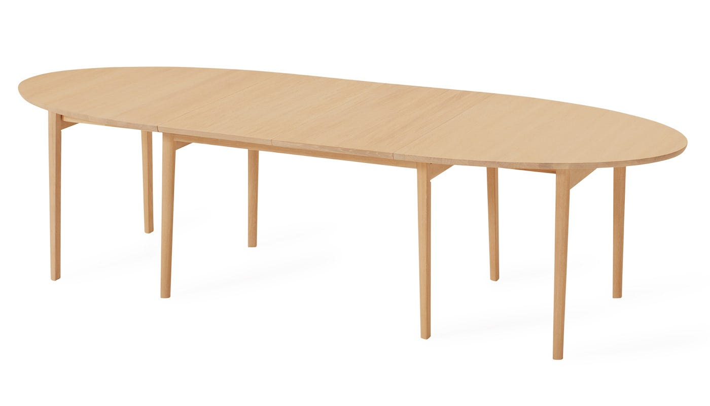 Ellipse Extending Table with two extension leaves in place - included