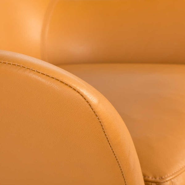 Beautifully upholstered arms create the ultimate comfort