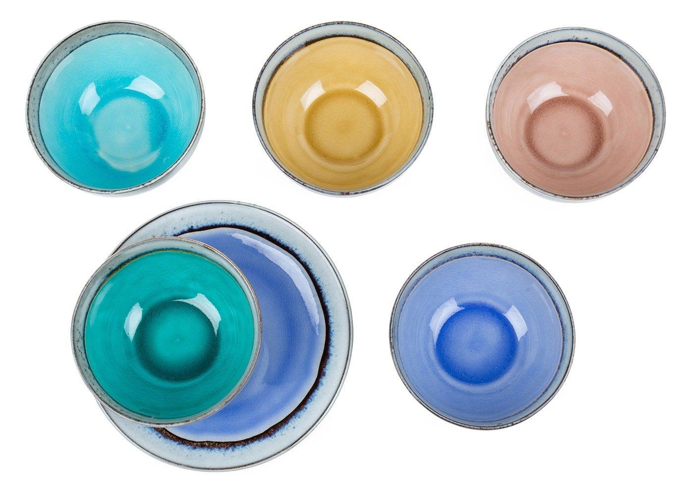 From left to right: Dakara bowl turquoise,Dakara bowl mustard,Dakara bowl pink,Dakara bowl green, Dakara plate, Dakara bowl blue