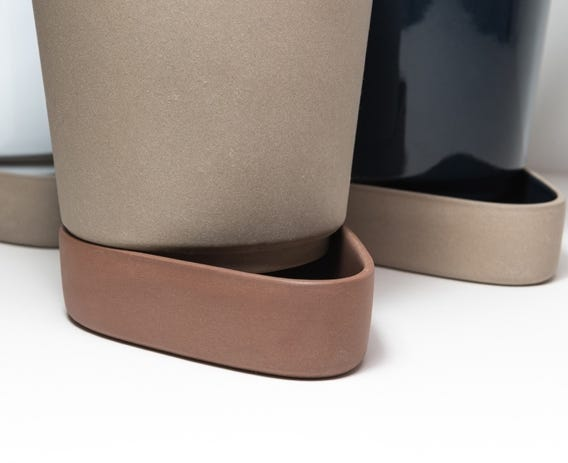 Minimally constructed the sip plant pot will always keep your plants well fed with its self watering system.