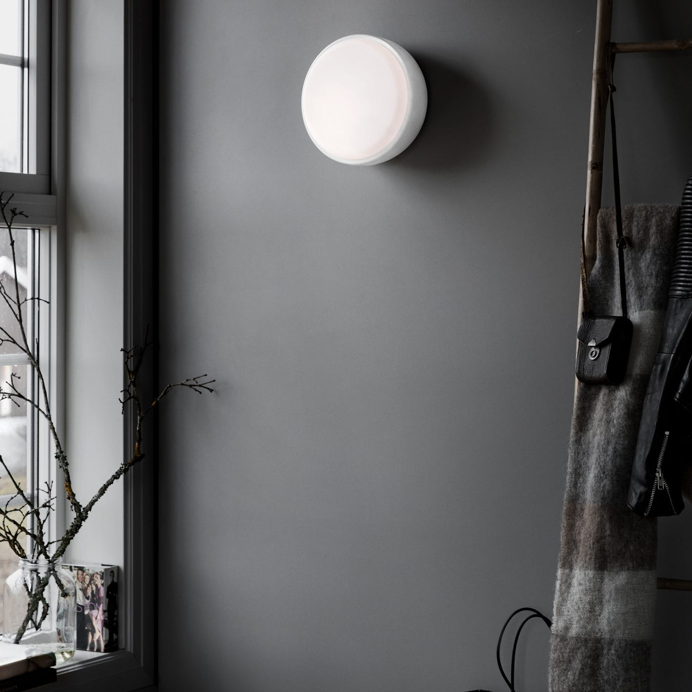 Over Me wall light in black.