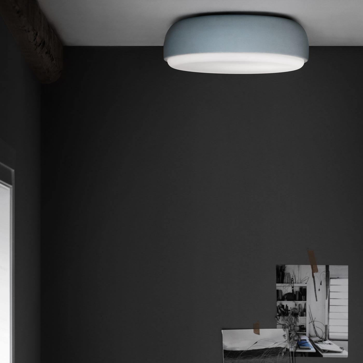 The Over Me light in dusty blue can be used a ceiling light.