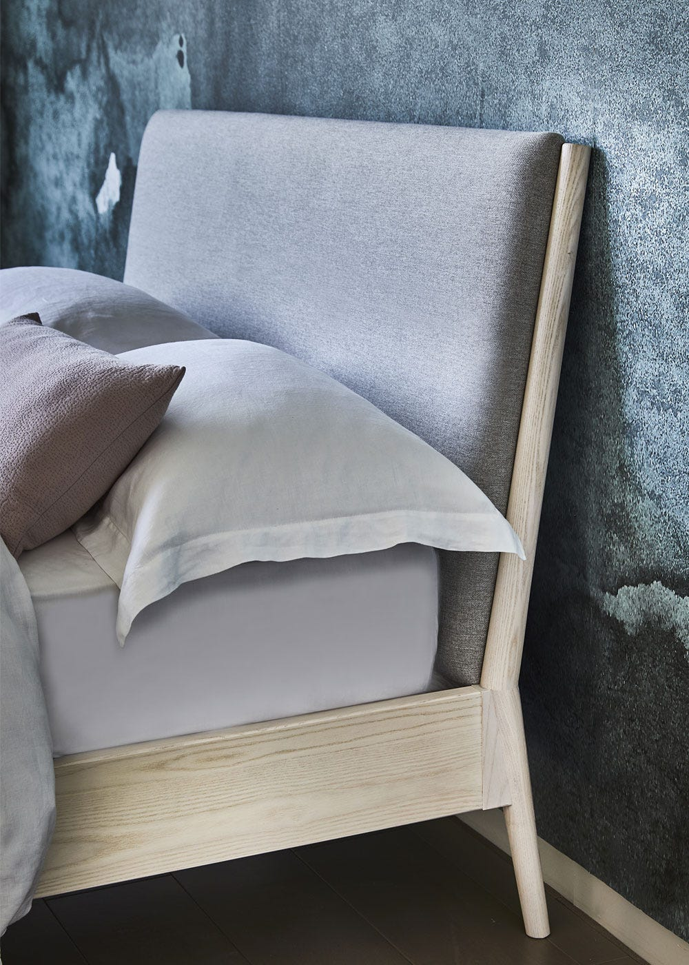 The salina bed comes with an upholstered headboard.