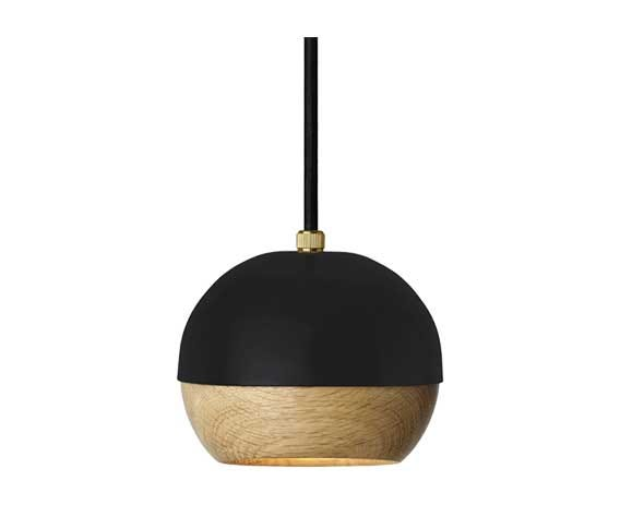 The wooden globe shade is mounted inside the steel shell with magnets so that the user can position the beam of light in any direction.