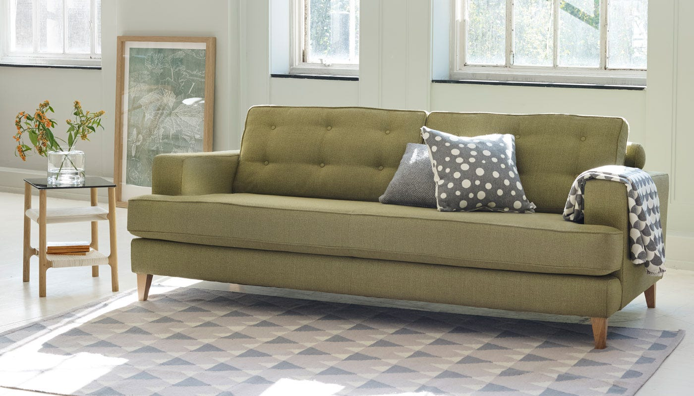 Boucle Wool Olive fabric with natural finish legs