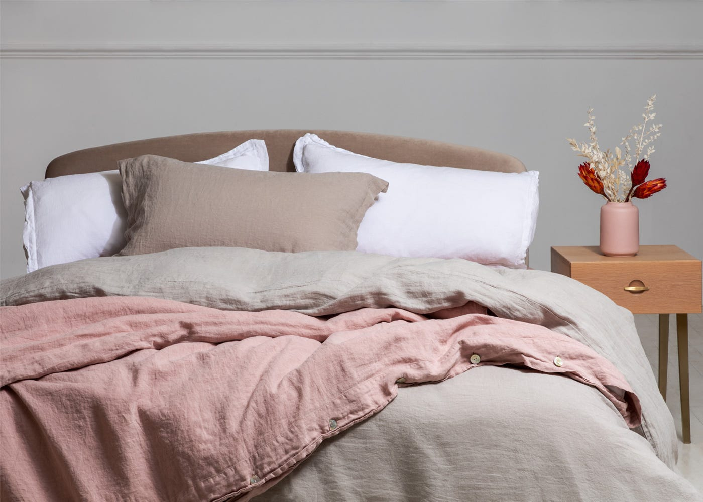 Mix and match with washed linen natural and white to add warmth and a fresh look to your bedroom