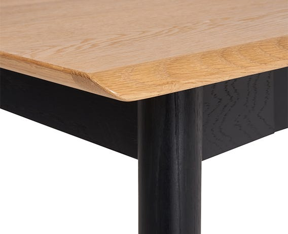 The Monza extending dining table has a striking textured brushed oak surface and legs in black finish that defines this collection.