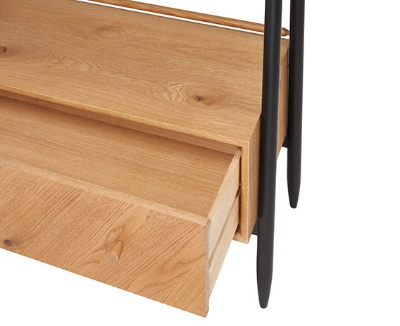 Three shelves and a deep drawer in brushed oak to maximise its storage capabilities all framed by the black statement legs that run up the full height.