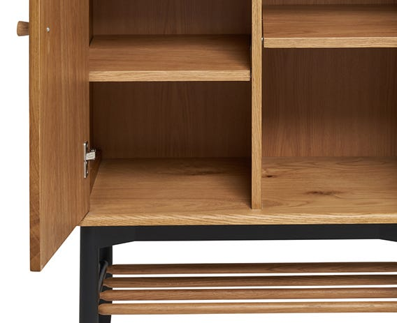 Functionality is further enhanced by the adjustable shelves and useful spindle shelf under the cabinet and framed by the elegant tapered black legs give a lightness of touch.