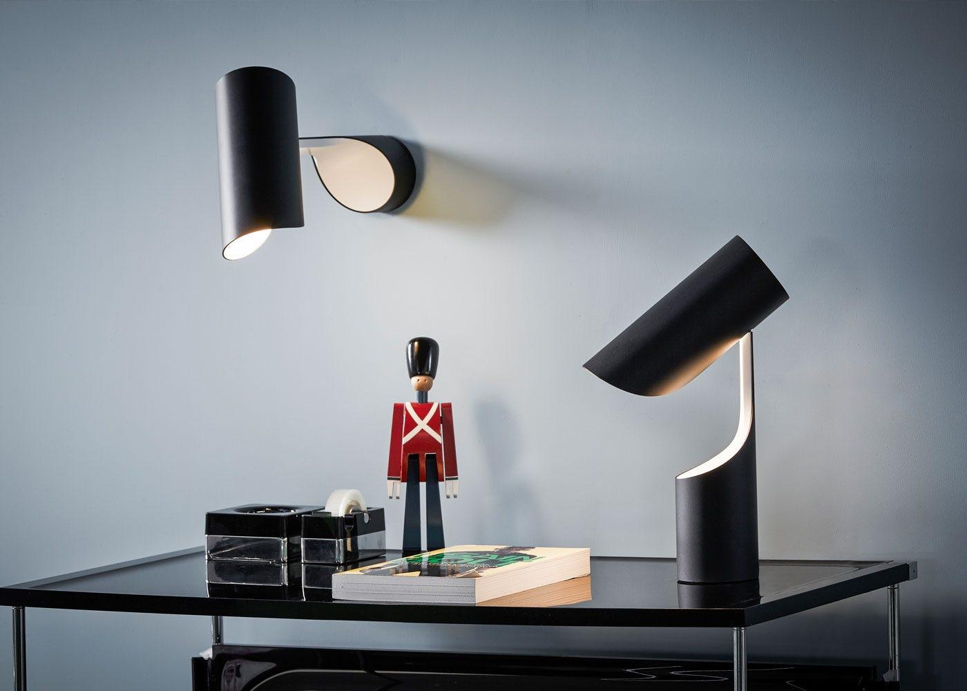 As shown: Mutatio Wall & table lamp in black.