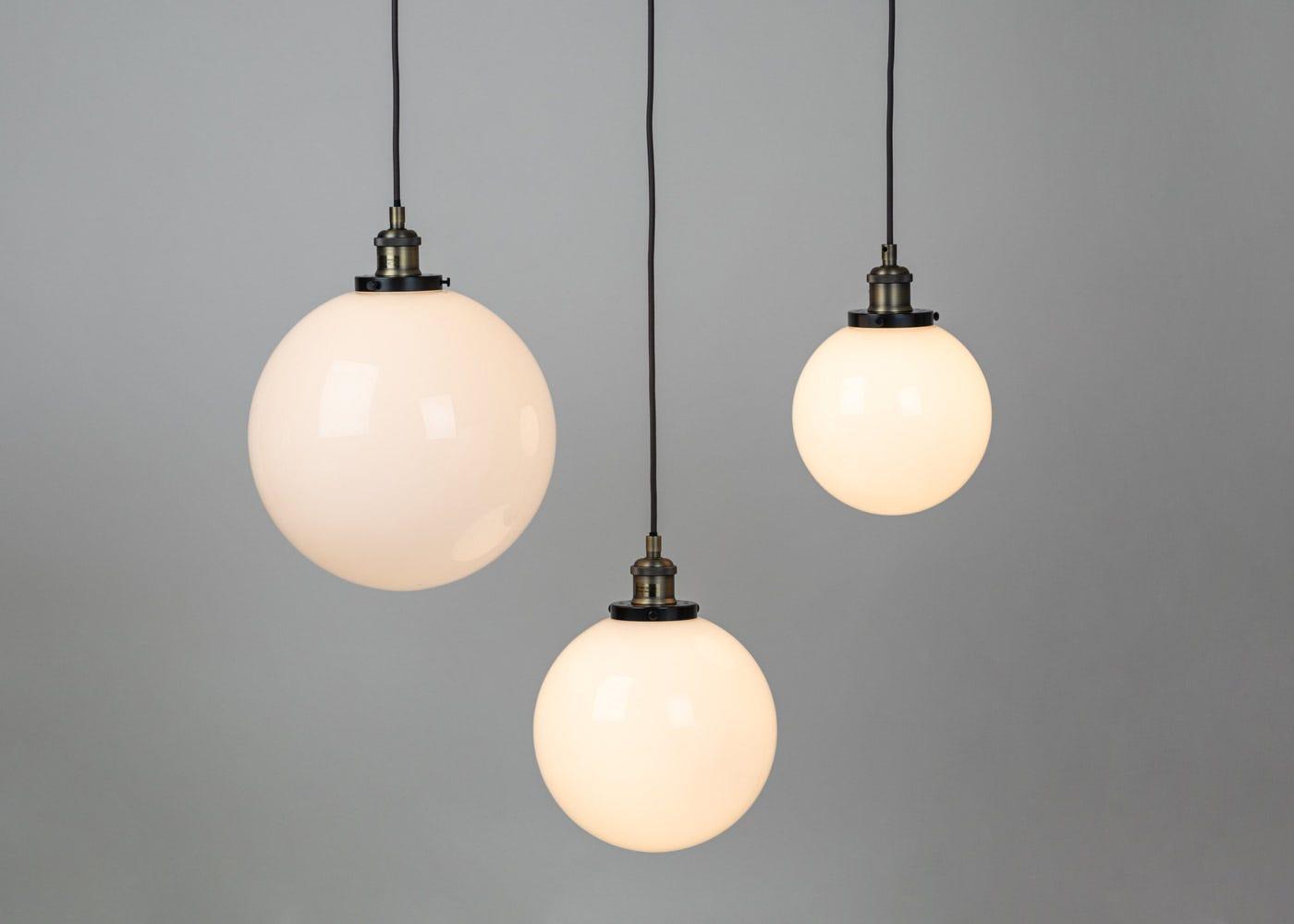 As shown: Olson white globes - On
