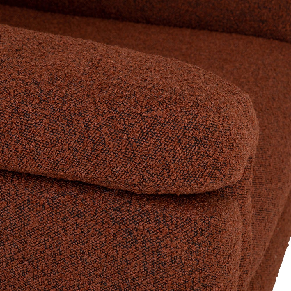 Rounded armrests are filled with soft feathers for sumptuous support