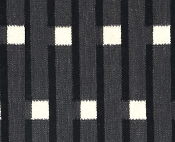 The strong lines in this rug is typical of an Eleanor Pritchard design, this specific design is inspired by London's architecture