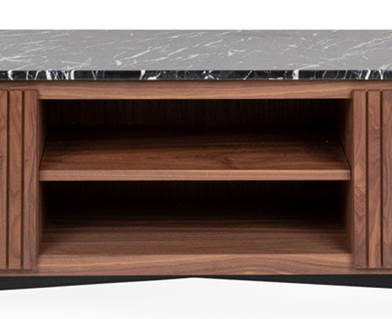 Functional storage area separated by a solid walnut shelf.