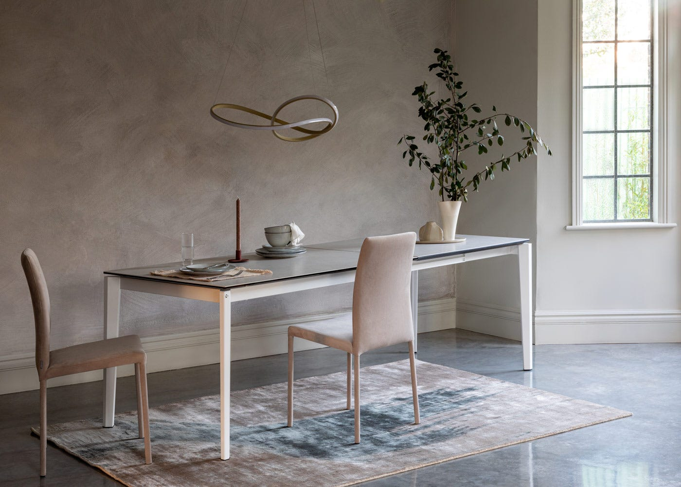As shown: The Rocca extended dining table in Salt White fully extended.
