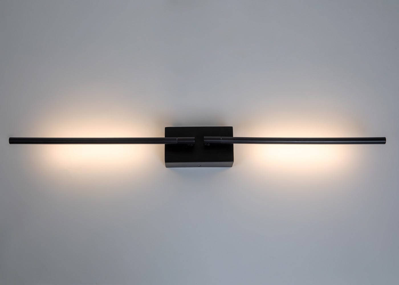 As shown: Saber LED wall light in black - On.
