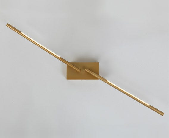 The Saber wall lights slim rectangular light source can direct light in multiple positions.