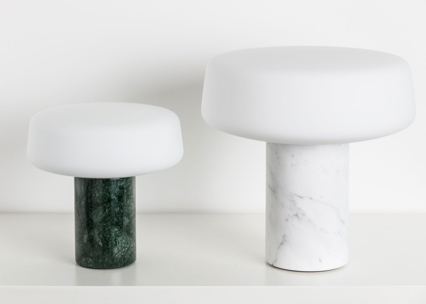 As shown (from left to right): Solid Table Lamp small in Nero Marquina Marble, Solid Table Lamp large in carrara marble