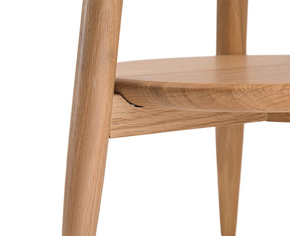 The versatile teramo side table in pale oak is elegantly understated, its timeless design perfect for both modern and classic homes. The small round tabletop and shelf below are supported by three outwardly splayed, tapering legs.