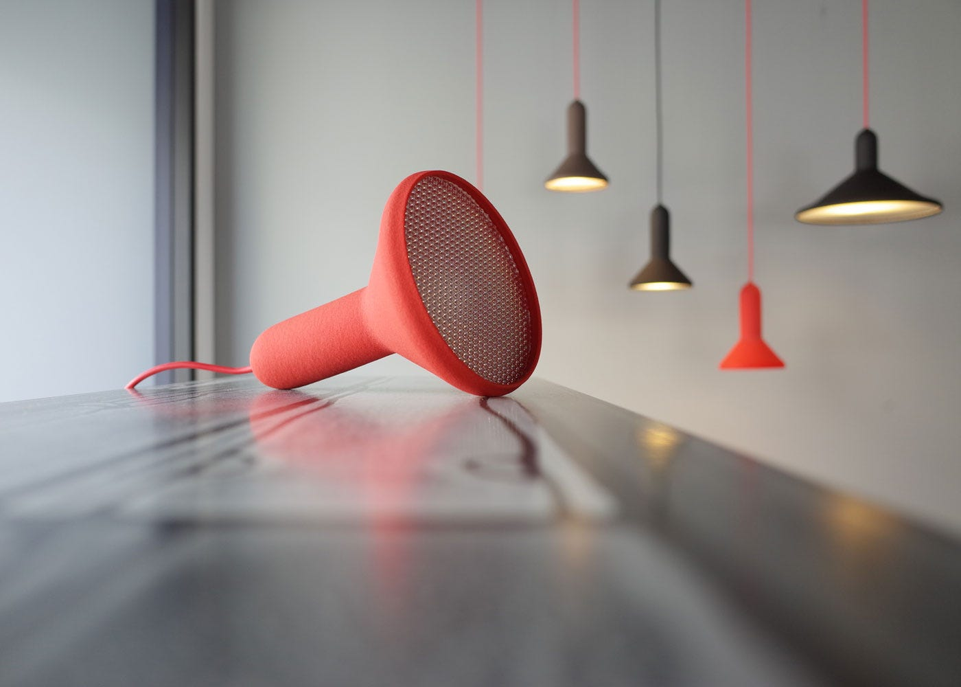As shown: Torch T1 Table lamp in red.