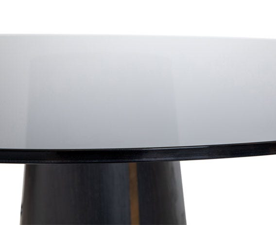 The glass top has a dark grey smoked finish and is radiused on the edges.