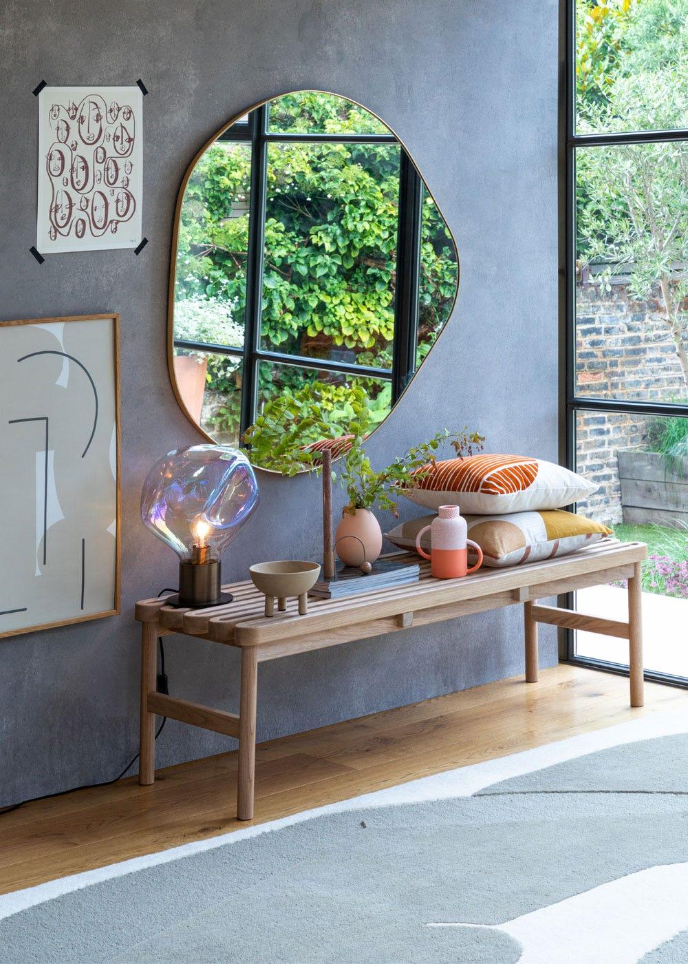 As shown: Bolha table lamp, organic fine edge mirror, studio gud twine bench.