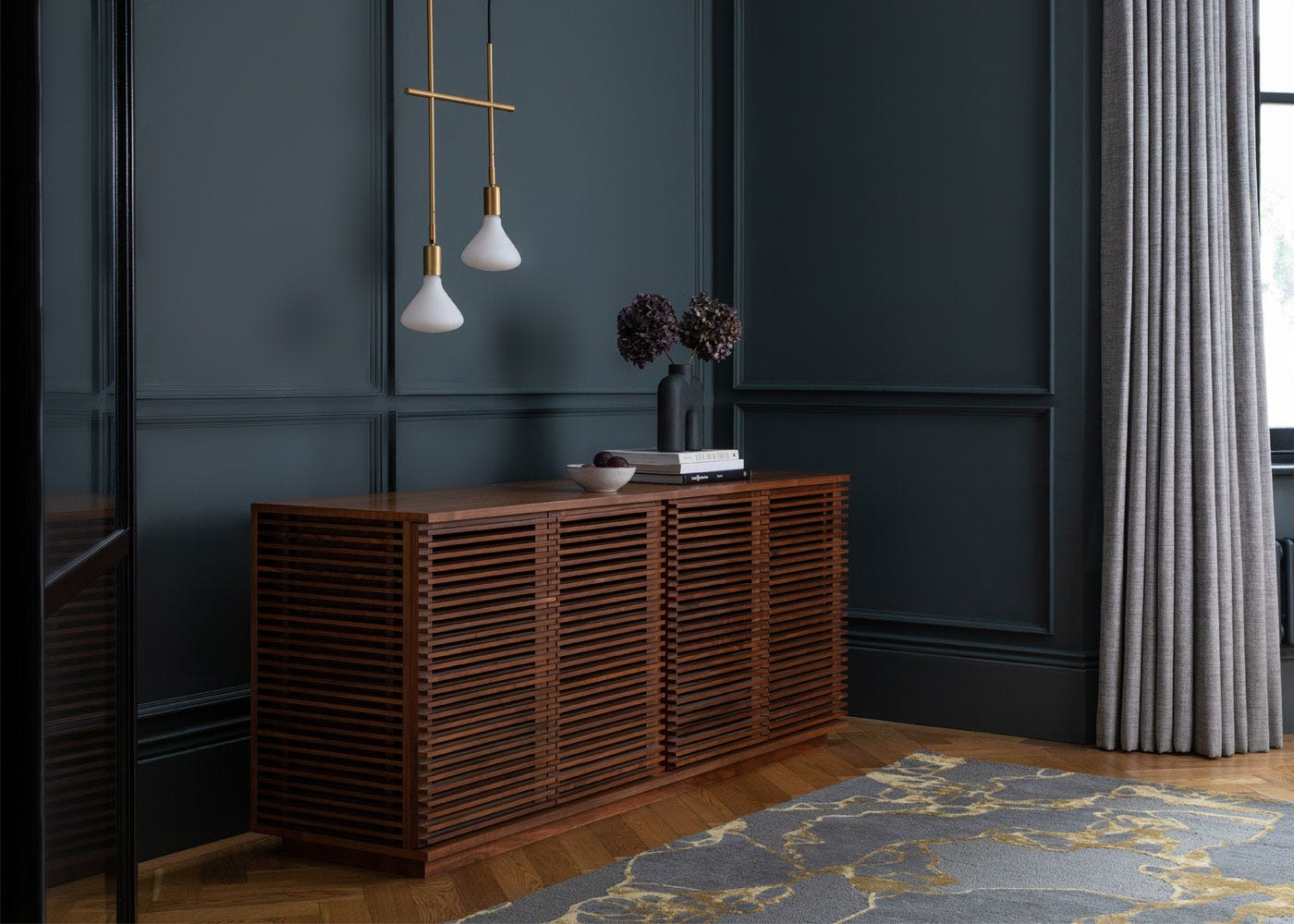 Twig 2 Arm Pendant Satin Brass paired with Verona Large Sideboard in Walnut.