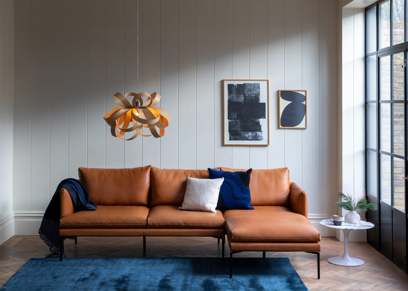 with Matera Corner Chaise and Skipper Pendant Light